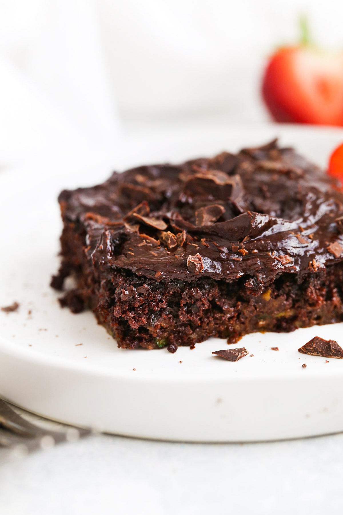 Close up view of a slice of Gluten Free Chocolate Zucchini Cake with Healthy Chocolate Frosting