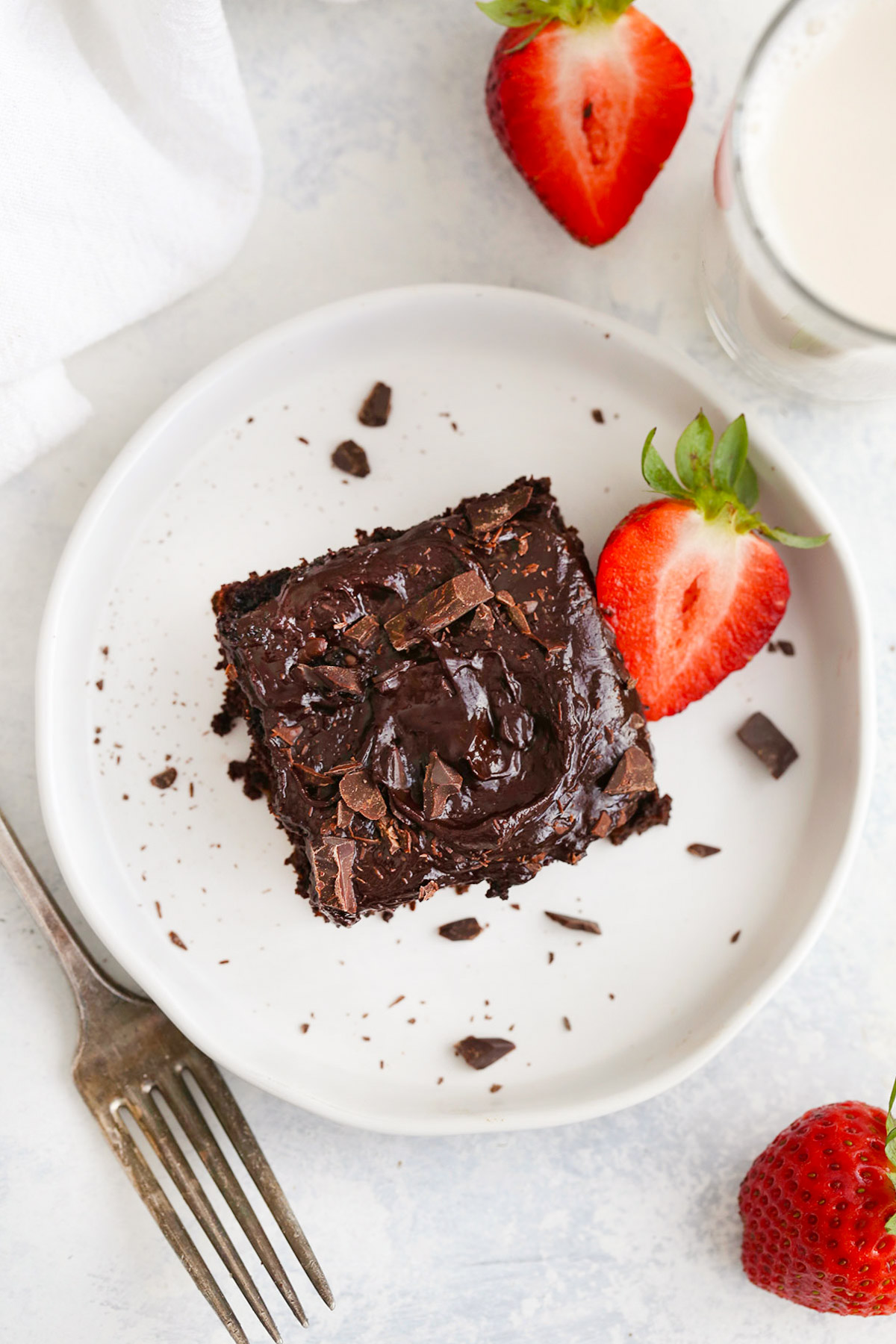 Overhead view of a slice of Gluten Free Chocolate Zucchini Cake with Healthy Chocolate Frosting