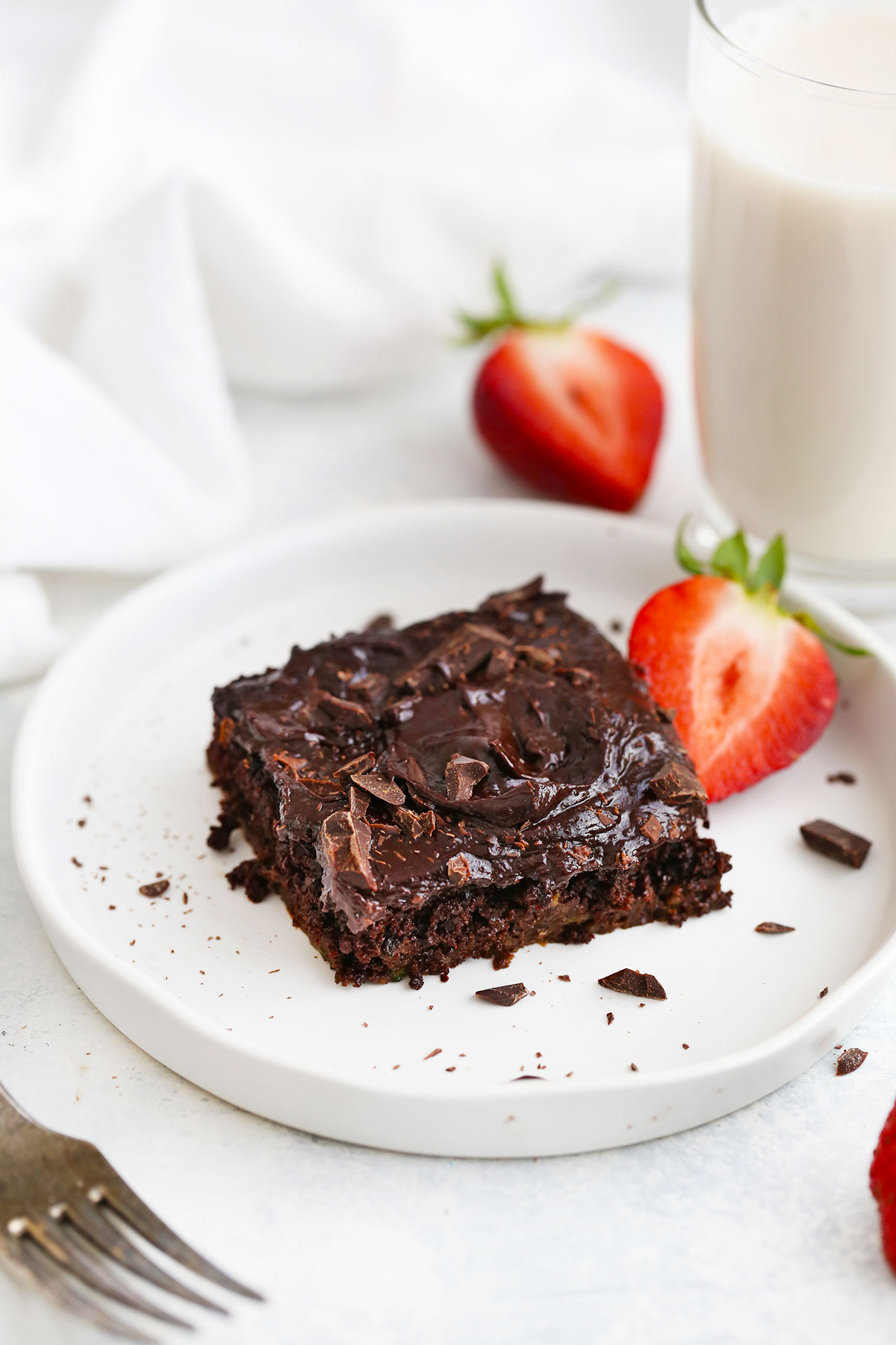 A slice of gluten free chocolate zucchini cake from One Lovely Life