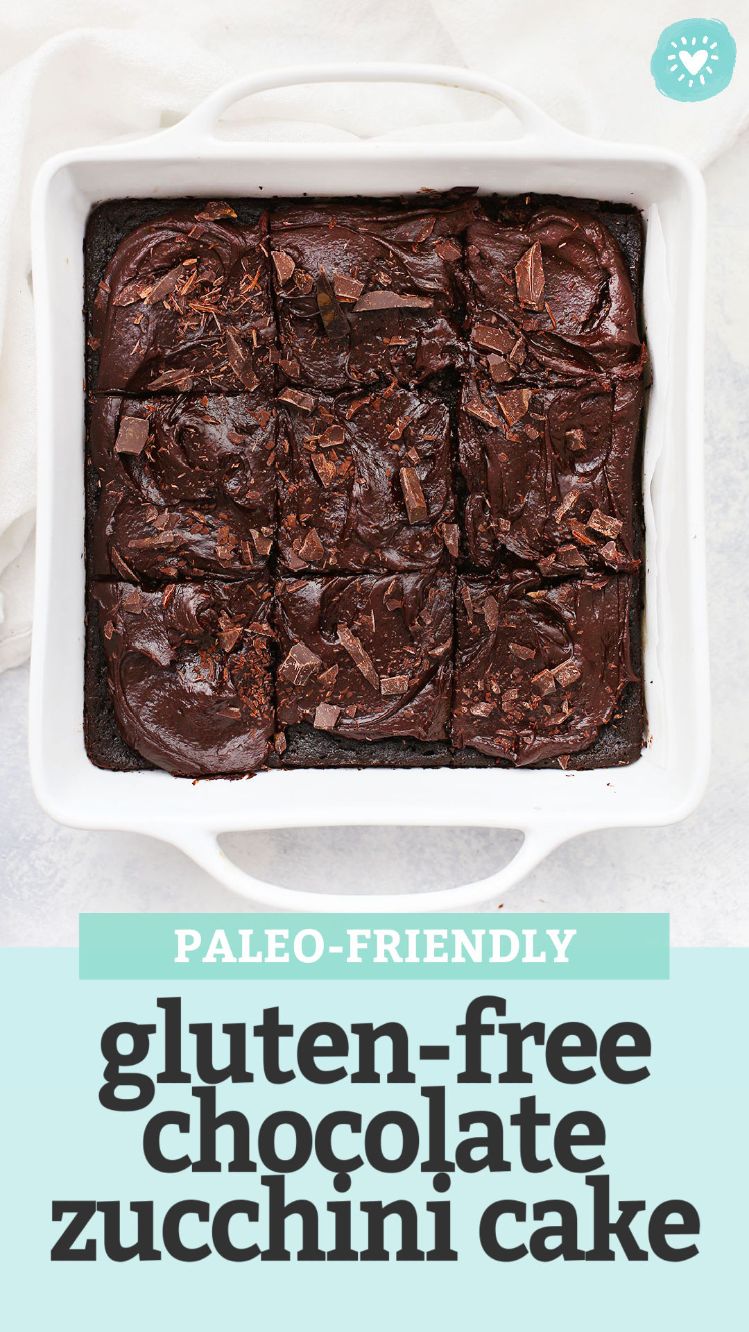 """Gluten Free Chocolate Zucchini Cake in a White 8x8 pan with text overlay that reads """"Paleo-Friendly Gluten-Free Chocolate Zucchini Cake"""""""