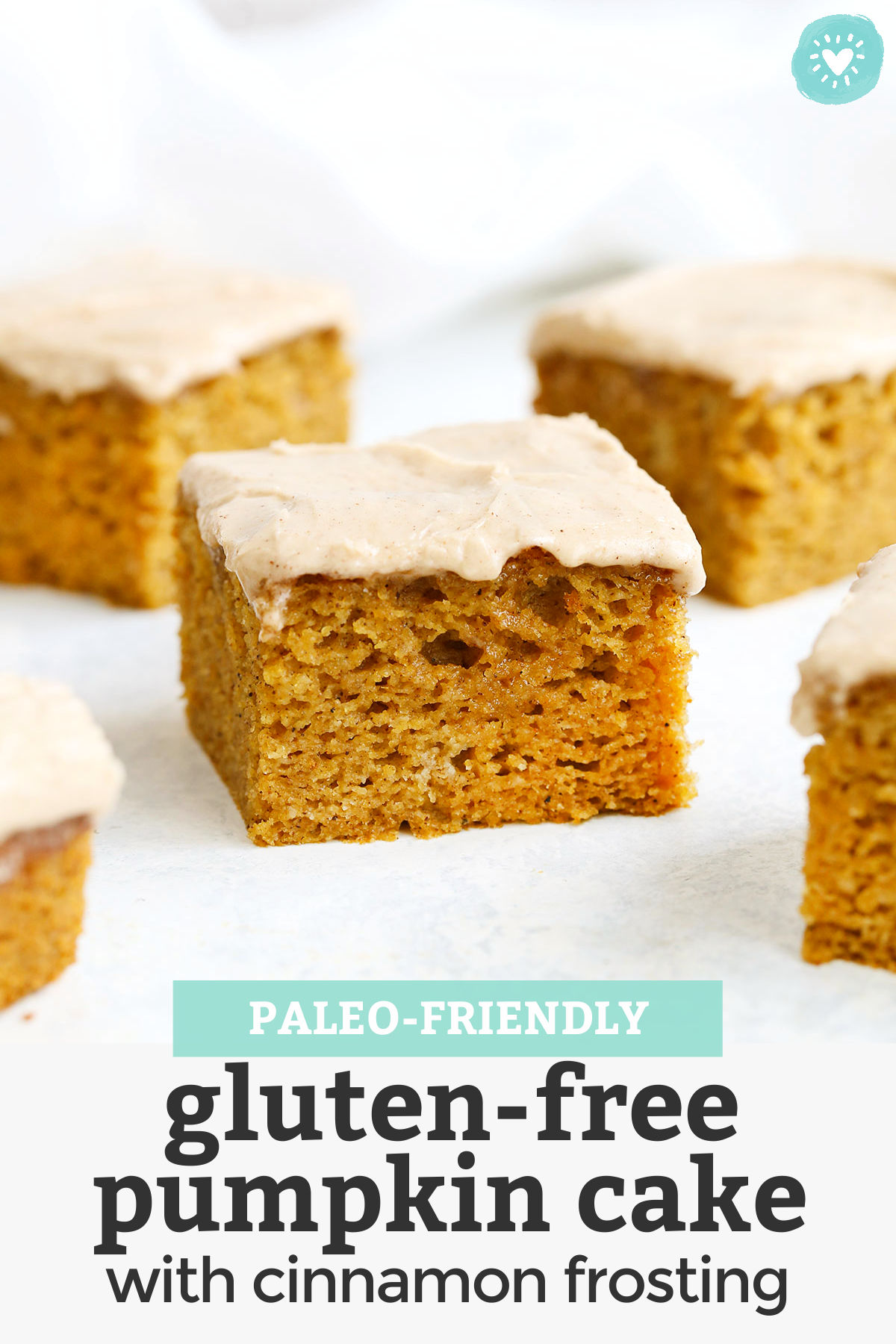 """Slices of gluten free pumpkin cake with cinnamon frosting with text overlay that reads """"Paleo Friendly Gluten Free Pumpkin Cake with Cinnamon Frosting"""""""