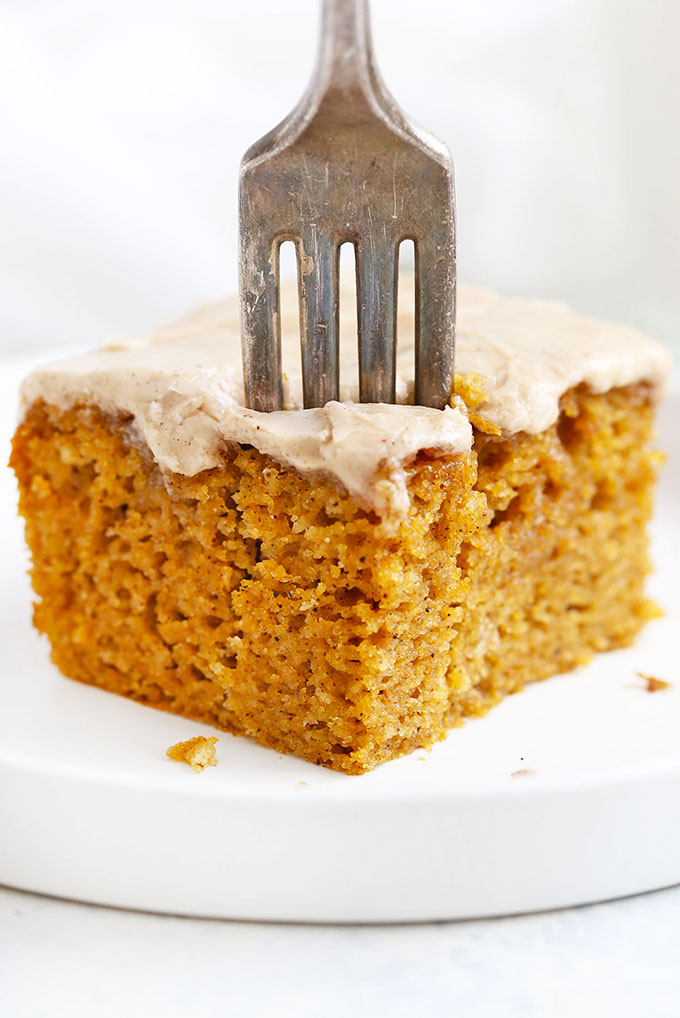 Fork taking a bite out of Gluten Free Pumpkin Cake with Cinnamon Frosting