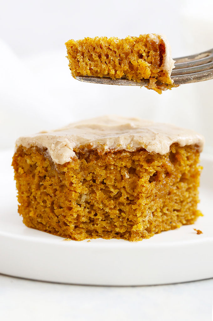 Fork lifting up a bite of Gluten Free Pumpkin Cake with Cinnamon Frosting