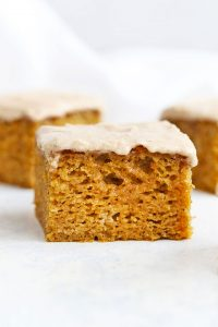 Slice of Gluten Free Pumpkin Cake with Cinnamon Frosting from One Lovely Life