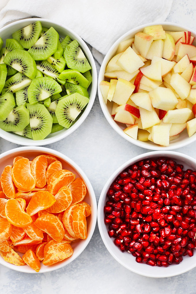 Apples, Oranges, Kiwi, and Pomegranate for Winter Fruit Salad with Citrus Dressing from One Lovely Life