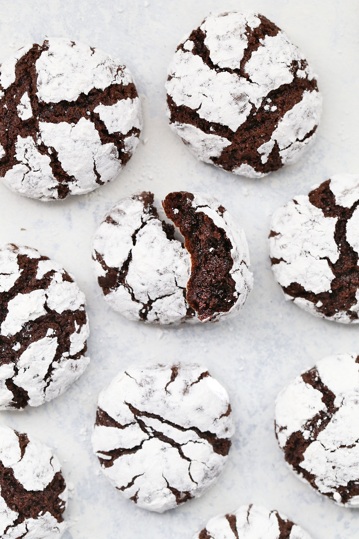 Overhead view of gluten-free chocolate crinkle cookies on a white background