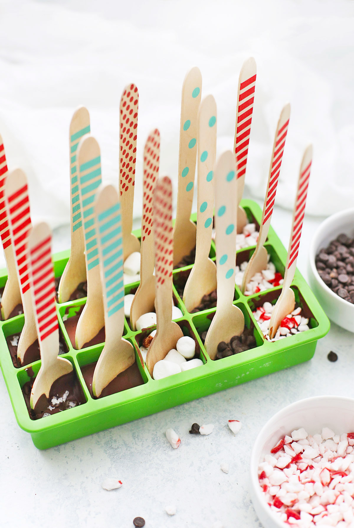 Dairy free, vegan, paleo hot chocolate spoons setting in a silicone ice cube mold