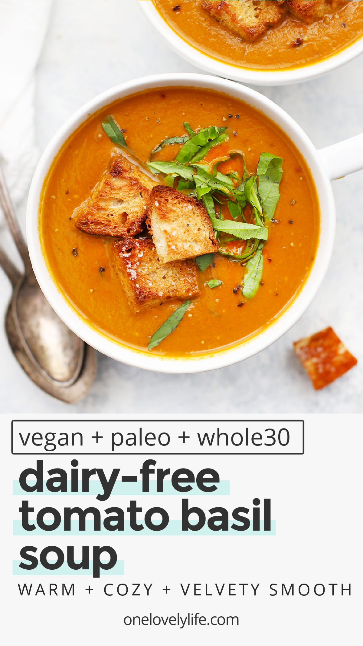 Creamy Tomato Basil Soup - You'd never guess that this creamy tomato soup is 100% vegan. It's full of deep, rich tomato basil flavor and a gorgeous velvety texture you'll fall for over and over again. (Vegan & Paleo) // Roasted Tomato Basil Soup Recipe // Paleo Tomato Basil Soup // Vegan Tomato Basil Soup #tomatosoup #vegan #paleo #dairyfree