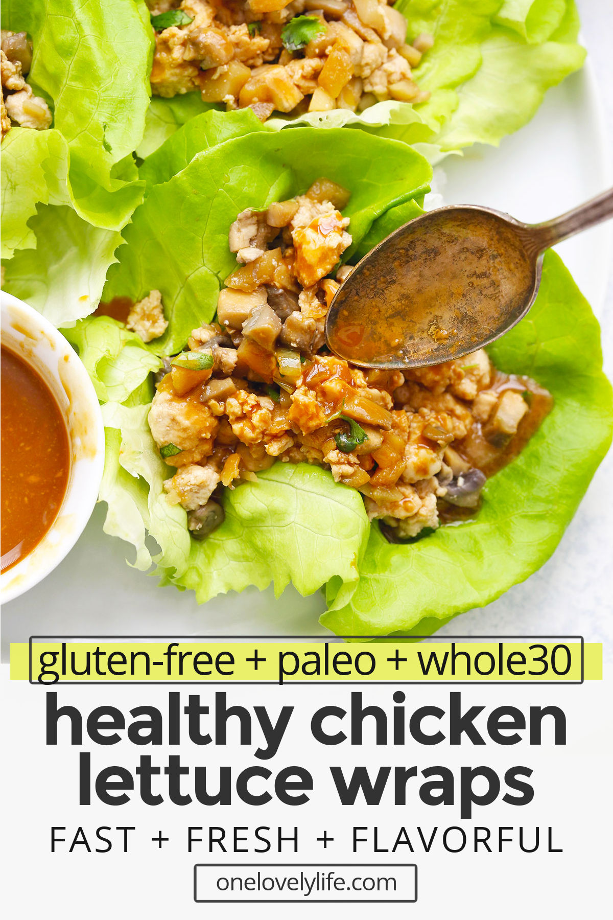 "Front view of Paleo Chicken Lettuce Wraps with text overlay that reads ""gluten-free + paleo + whole30 healthy chicken lettuce wraps: Fast + fresh + flavorful"""