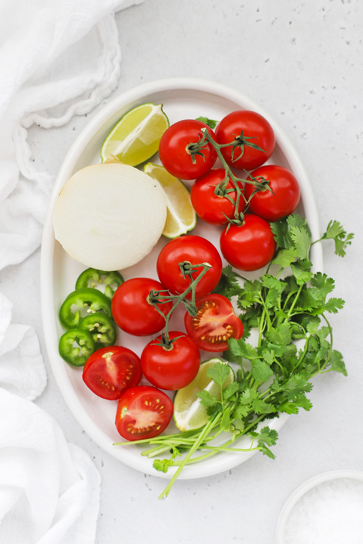 Overhead view of a platter of ingredients for pico de gallo