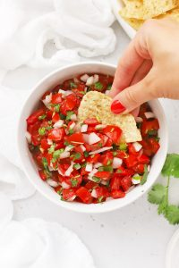 Overhead view of a bowl of authentic pico de gallo with chips
