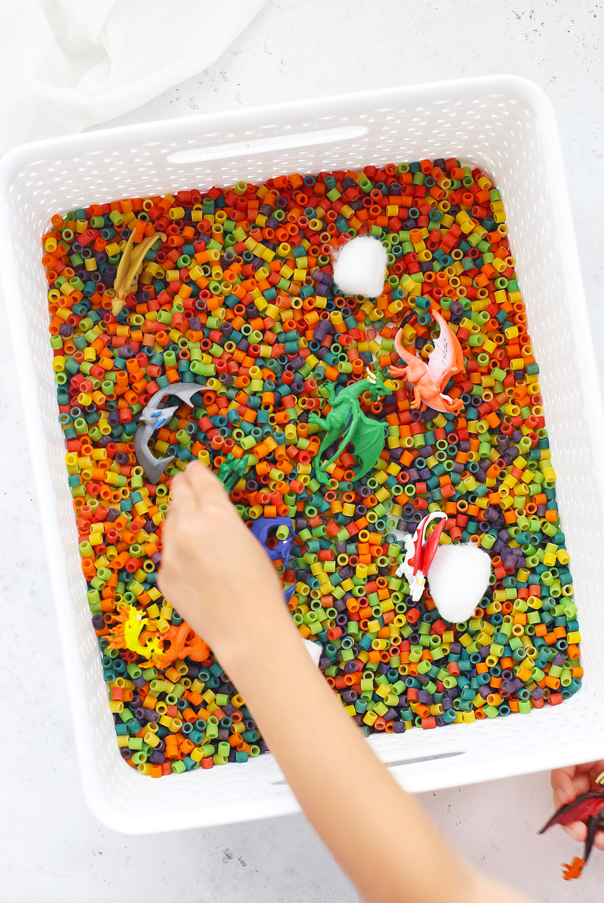 Dragon Sensory Bin with Rainbow Pasta