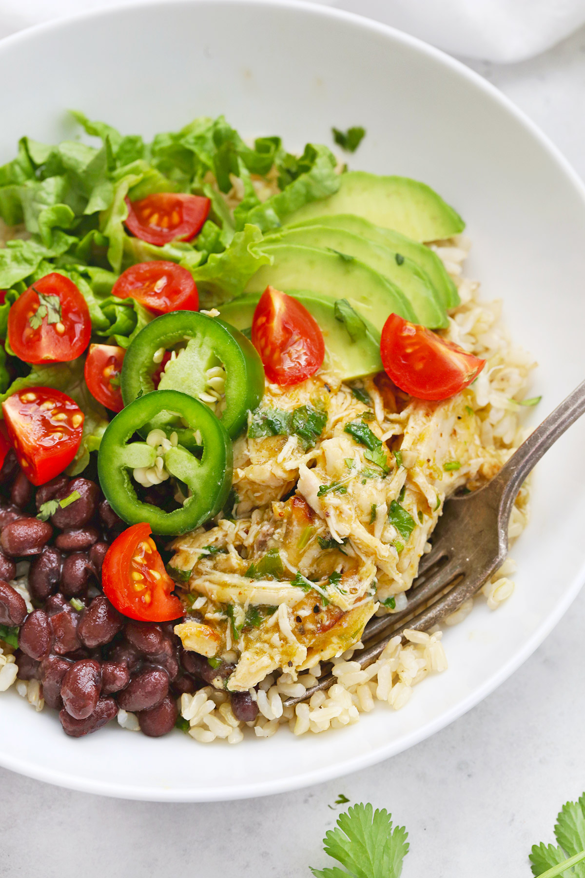 Instant Pot Salsa Verde Chicken in a Burrito Bowl