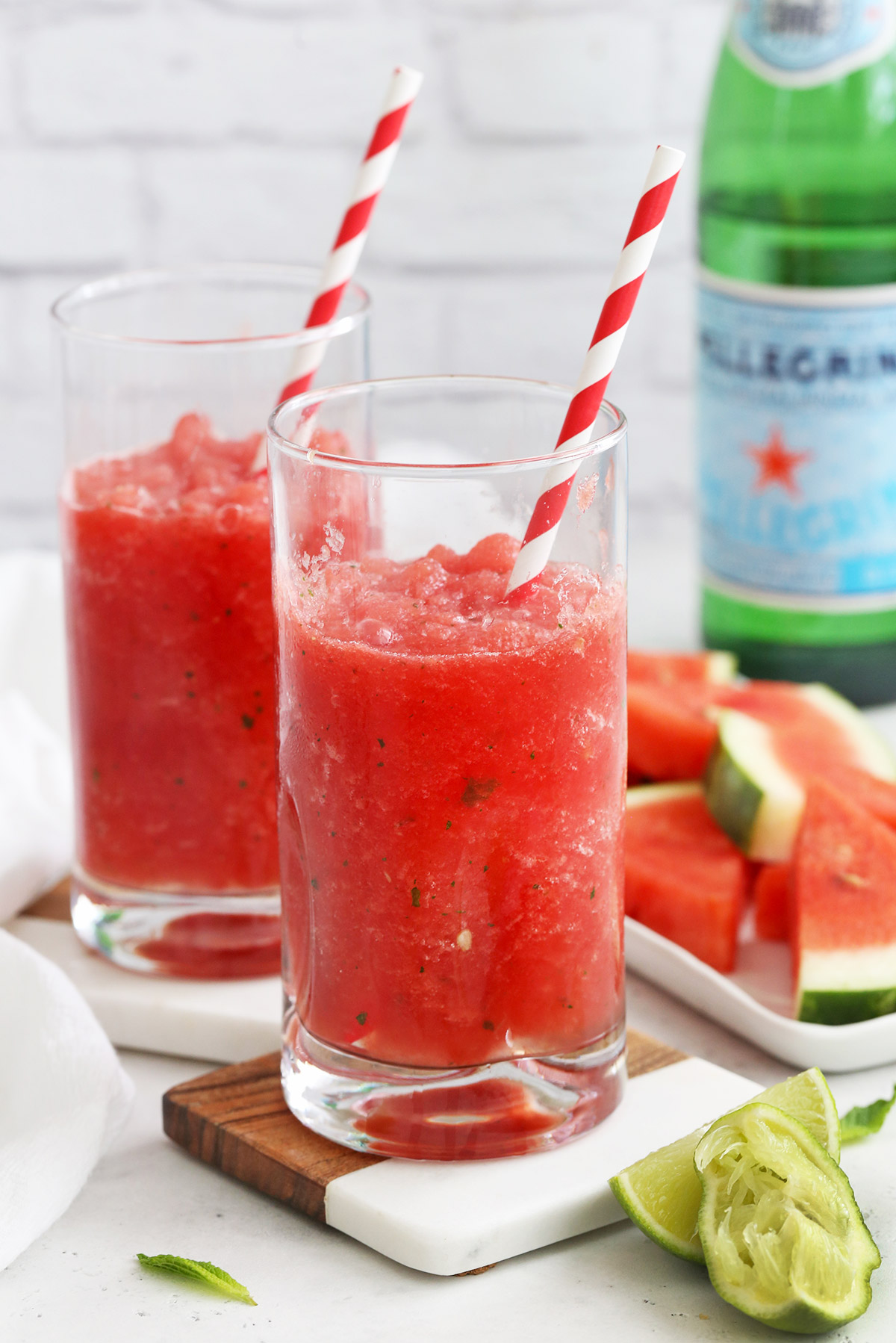 Front View of Watermelon Slushies in Glasses with Red and White Striped Straws