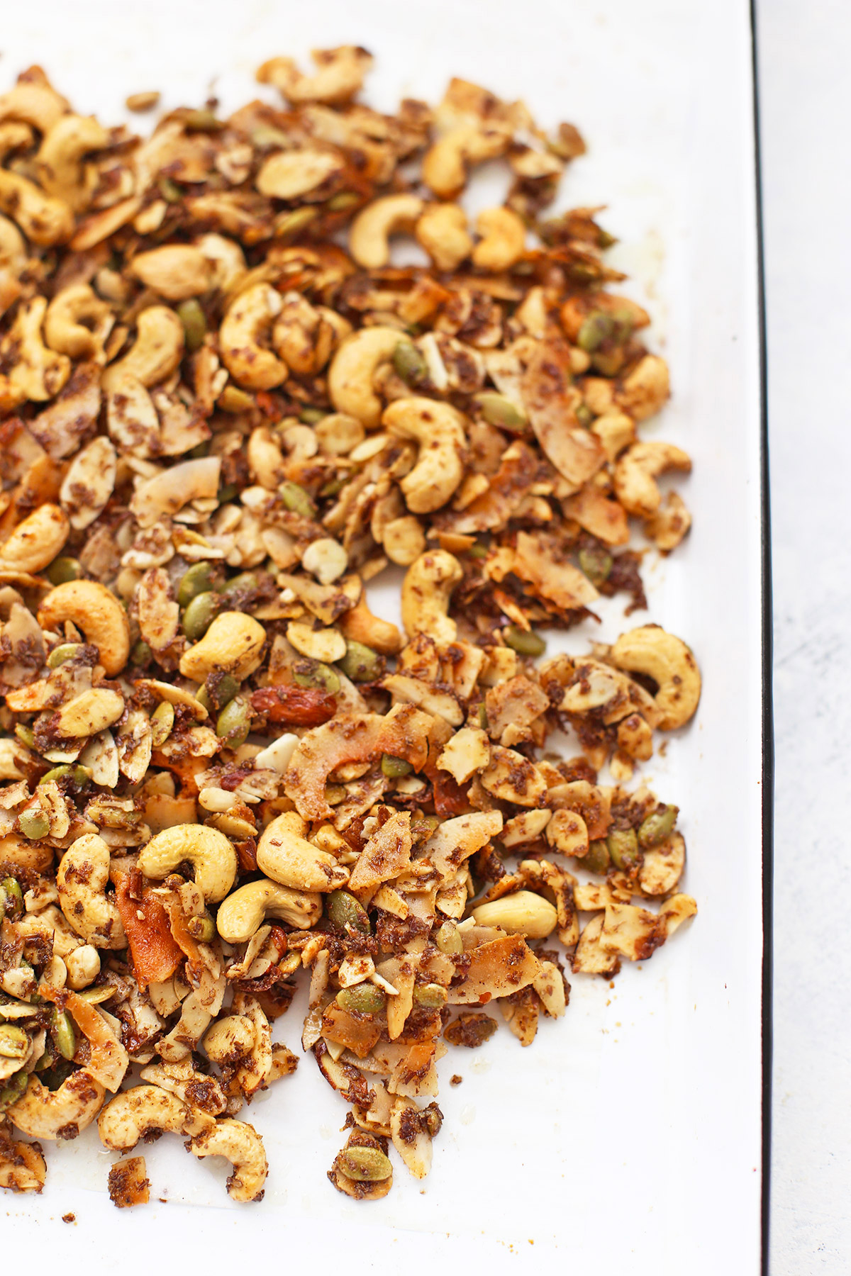 White sheet pan with paleo granola cooling