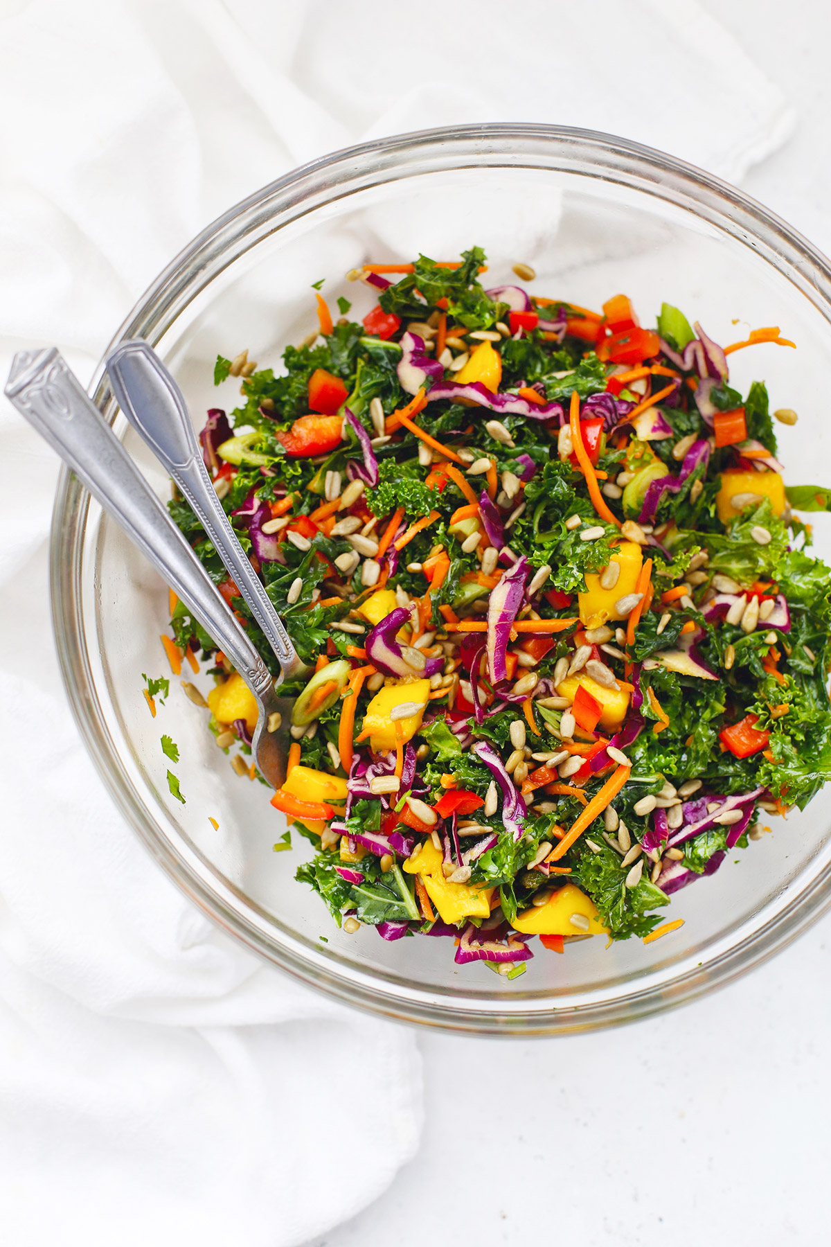 Asian Kale Crunch Salad in a glass salad bowl