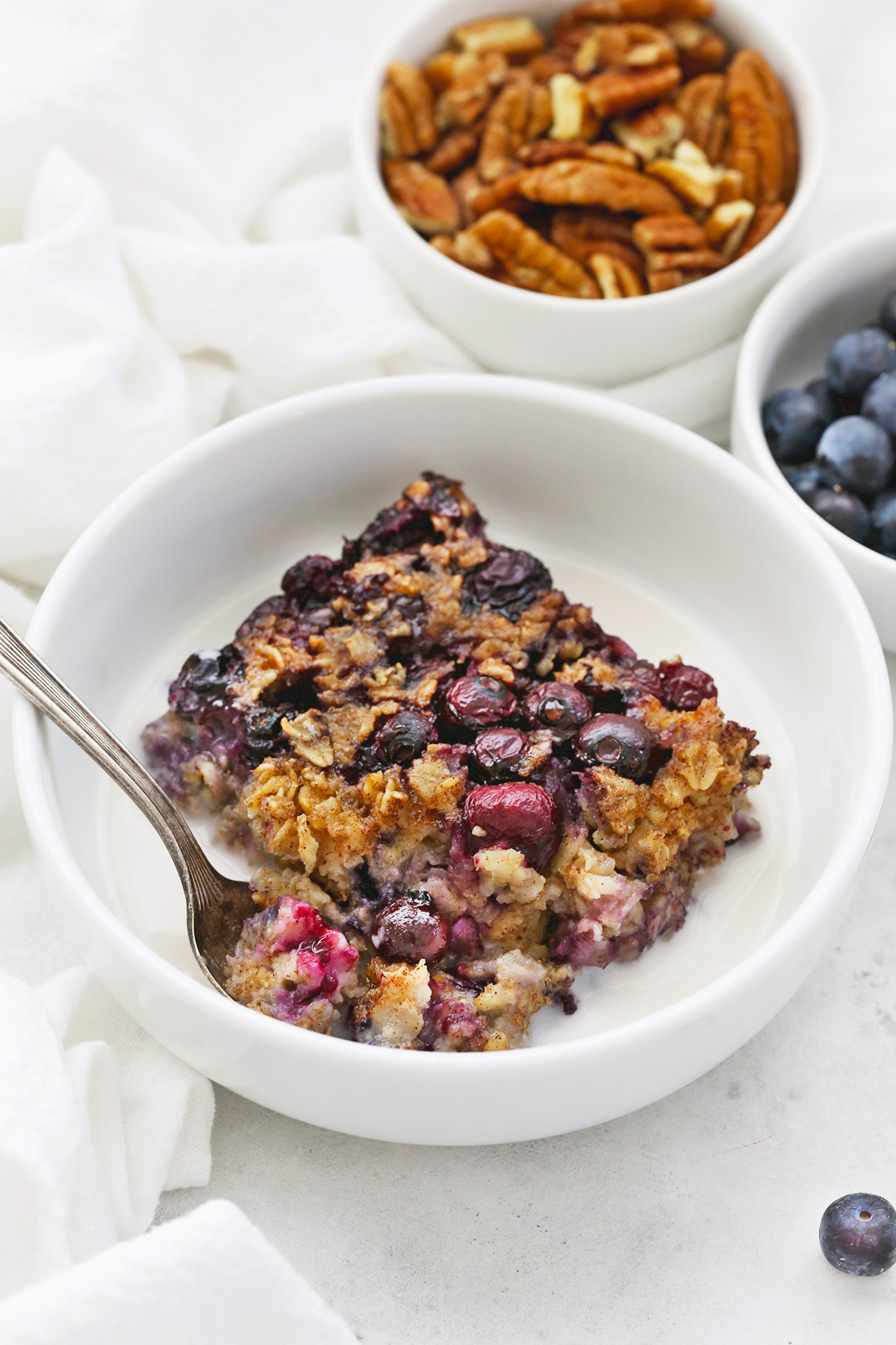 Front view of blueberry baked oatmeal with almond milk