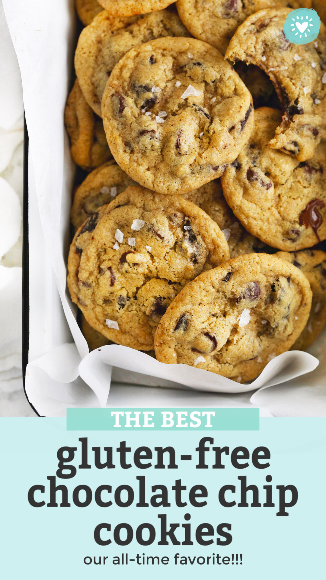 """Overhead photo of gluten free chocolate chip cookies in a white enamel pan with text overlay that reads """"The Best Gluten-Free Chocolate Chip Cookies--our all-time favorite!"""""""