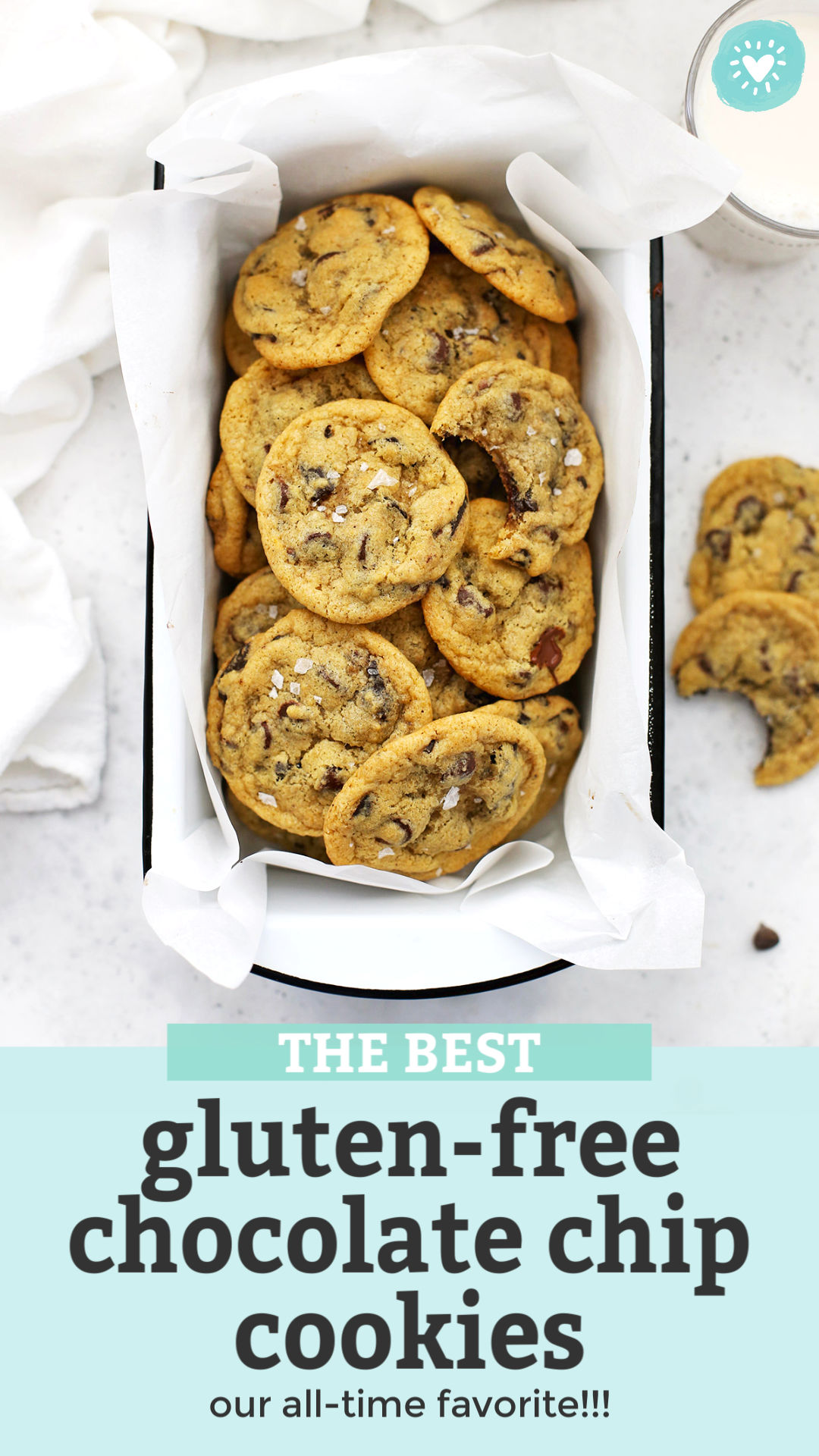 """Close-up Overhead photo of gluten free chocolate chip cookies in a white enamel pan with text overlay that reads """"The Best Gluten-Free Chocolate Chip Cookies--our all-time favorite!"""""""