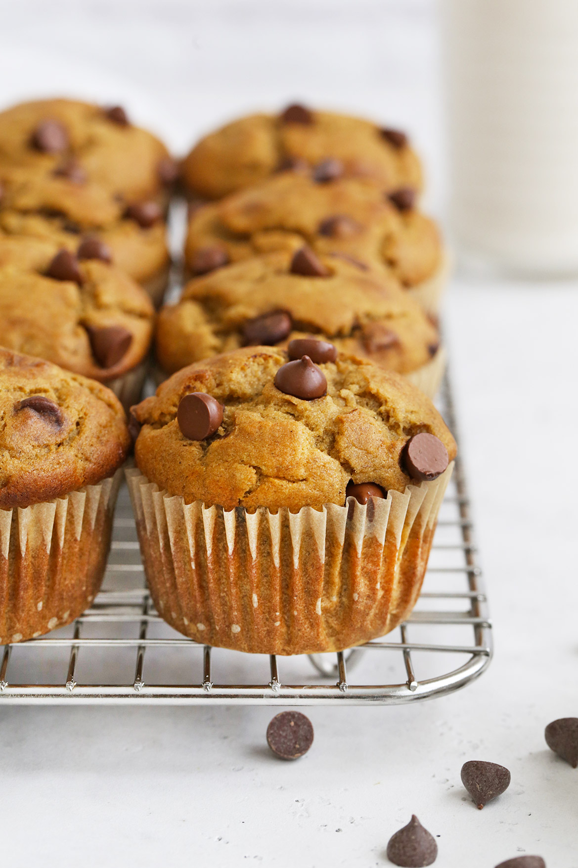 Front view of gluten-free banana chocolate chip muffins on a cooling rack.