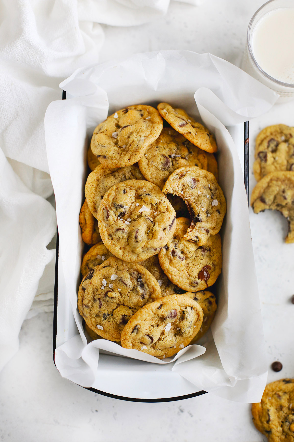 Overhead photo of gluten free chocolate chip cookies in a white enamel pan