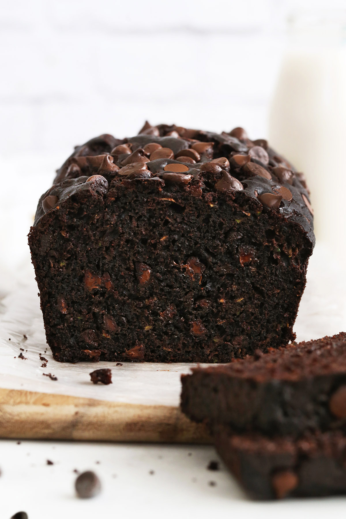A front view of a sliced loaf of gluten free chocolate zucchini bread