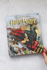 Illustrated copy of Harry Potter and the Sorcerer's Stone on a white background