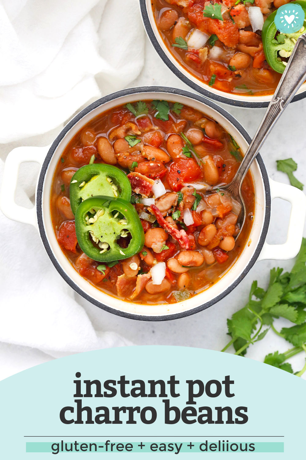 "Two bowls of Instant Pot Charro Beans on a white background with text overlay that reads ""Instant Pot Charro Beans. Gluten-Free + Easy + Delicious"""