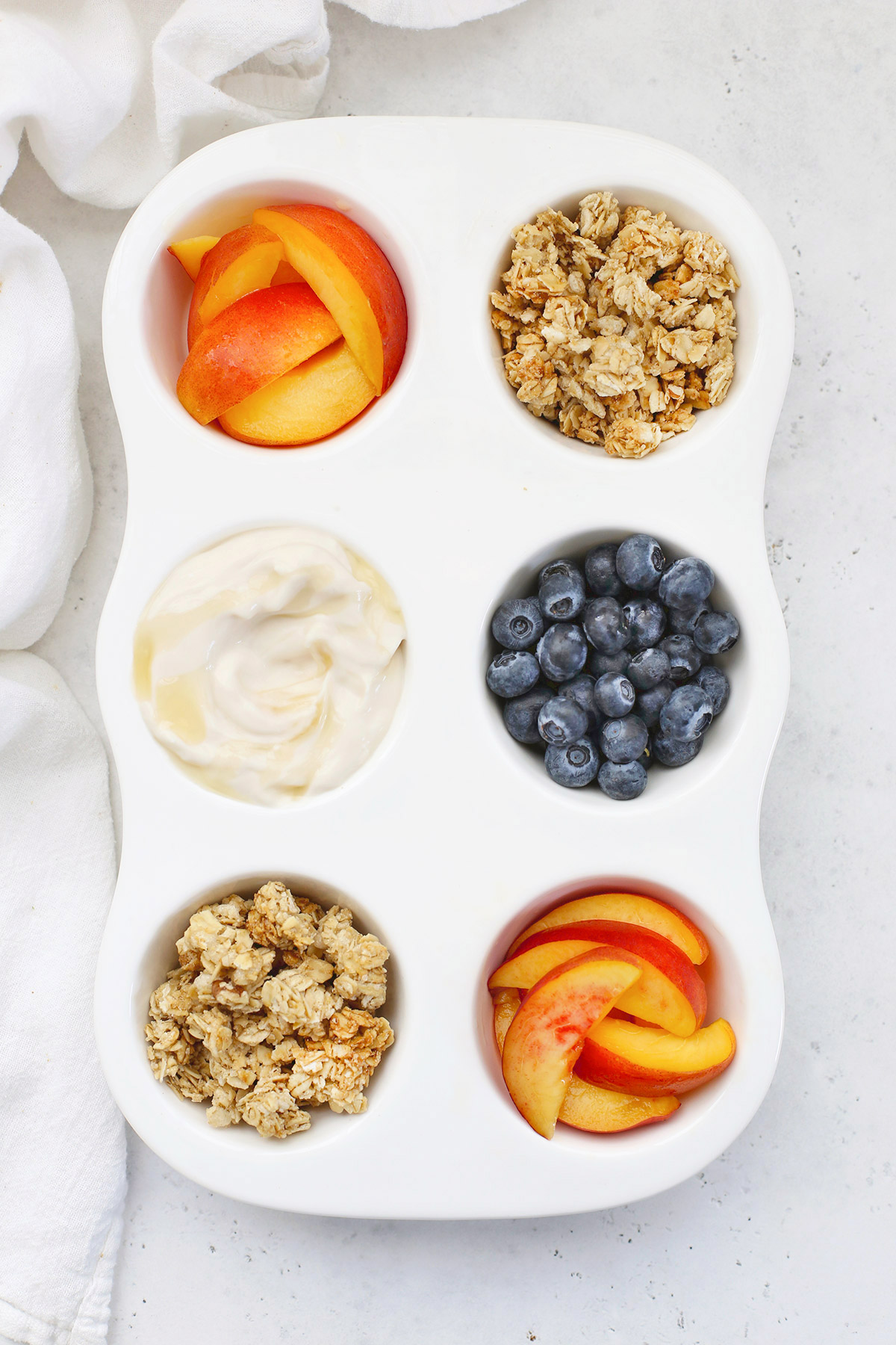 Muffin Tin Snack Tray For Kids with Nectarines, Gluten-Free Granola, Vegan Yogurt and Blueberries