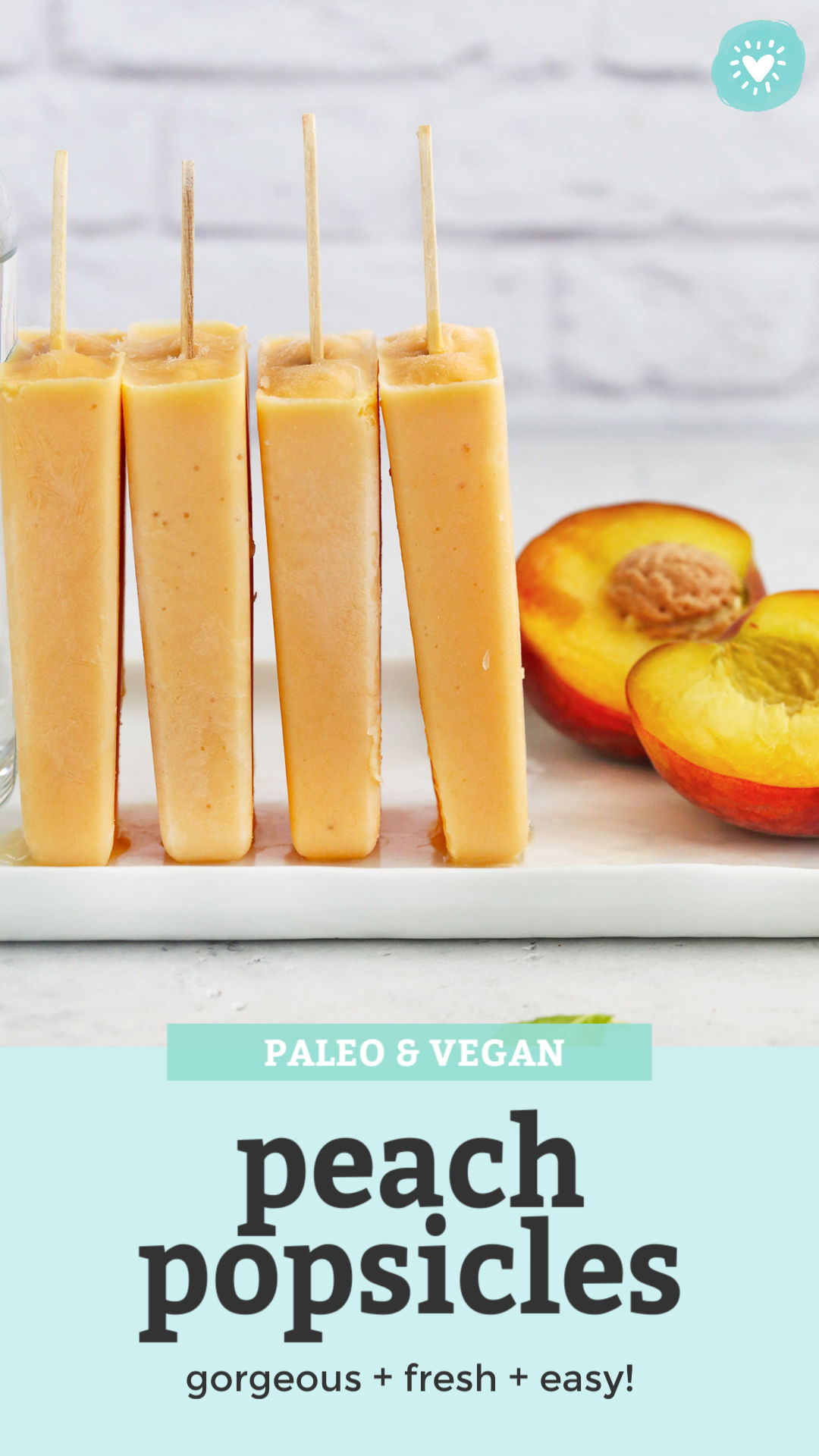 "Peach Popsicles upright leaning on each other with a split peach in the background with text overlay that reads ""Paleo & Vegan Peach Popsicles. gorgeous + fresh + easy!"""