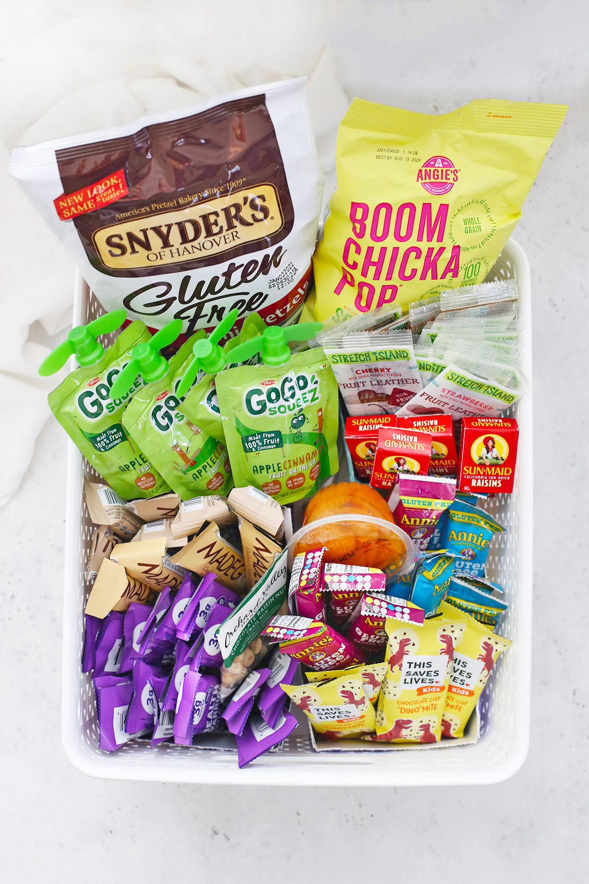 A white basket full of gluten-free snack foods