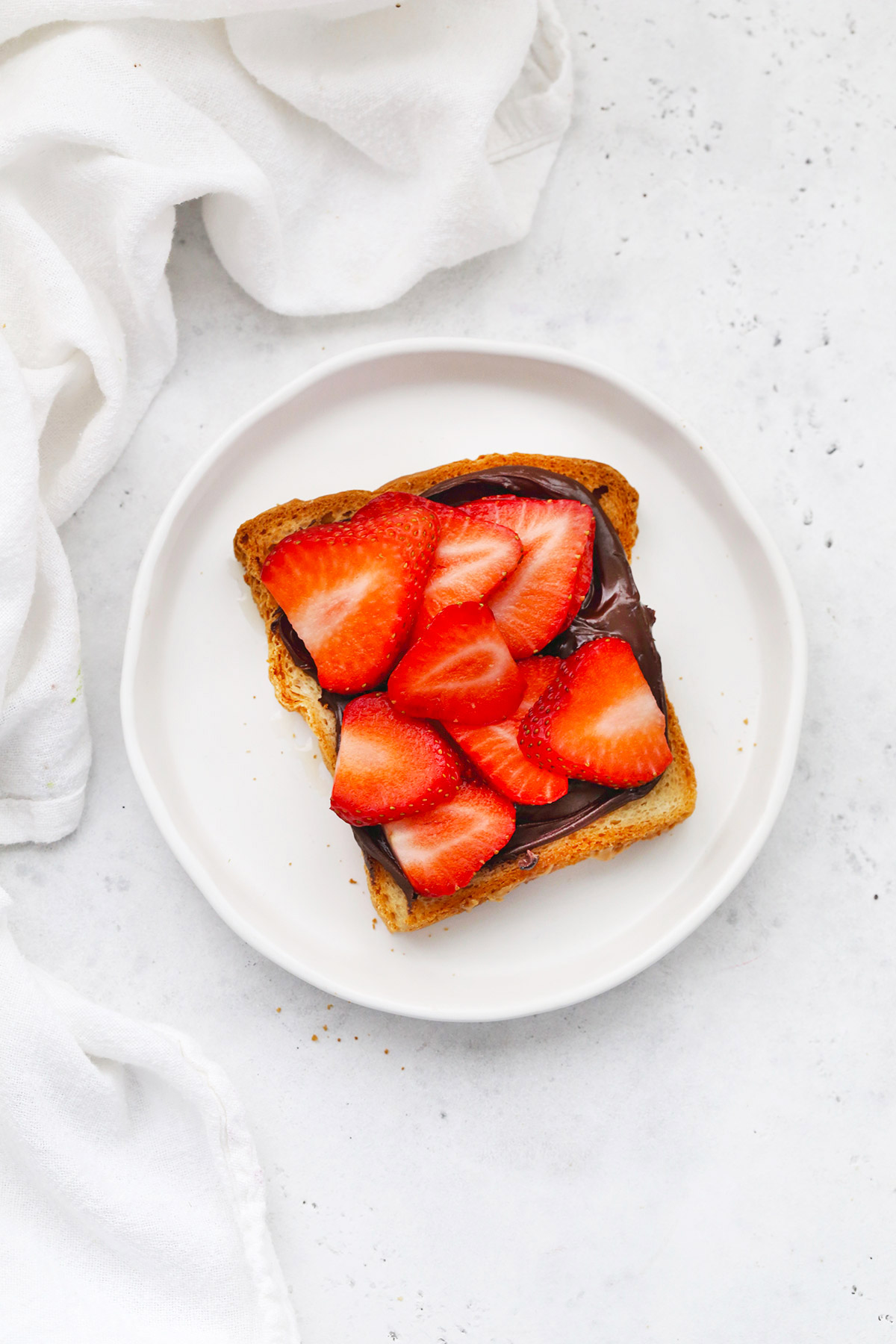 Gluten Free Toast with Vegan Nutella and Strawberries