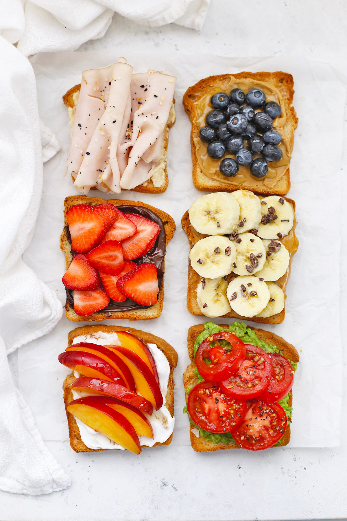 Six Slices of Gluten-Free toast with different toppings on a white background.