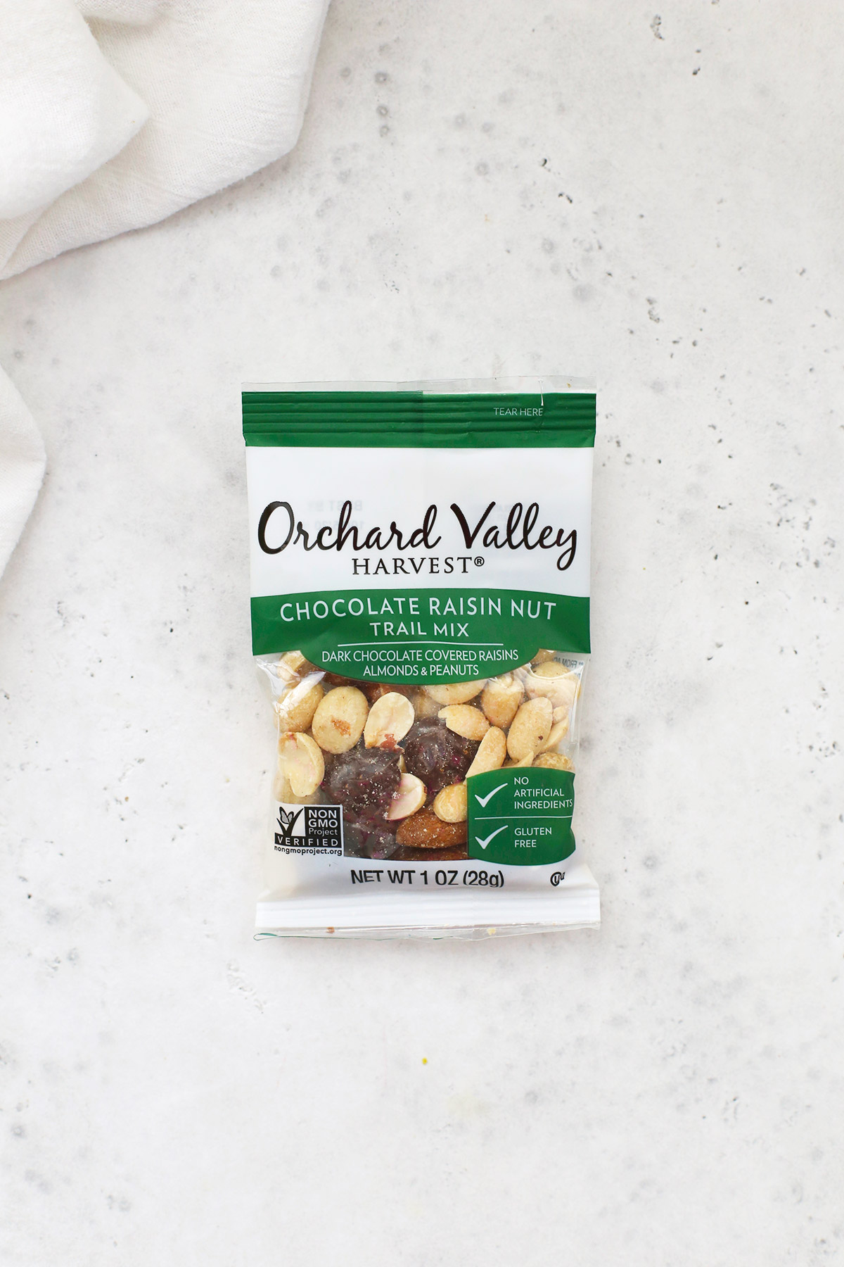 A bag of Orchard Valley Harvest Chocolate Raisin Trail Mix on a white background