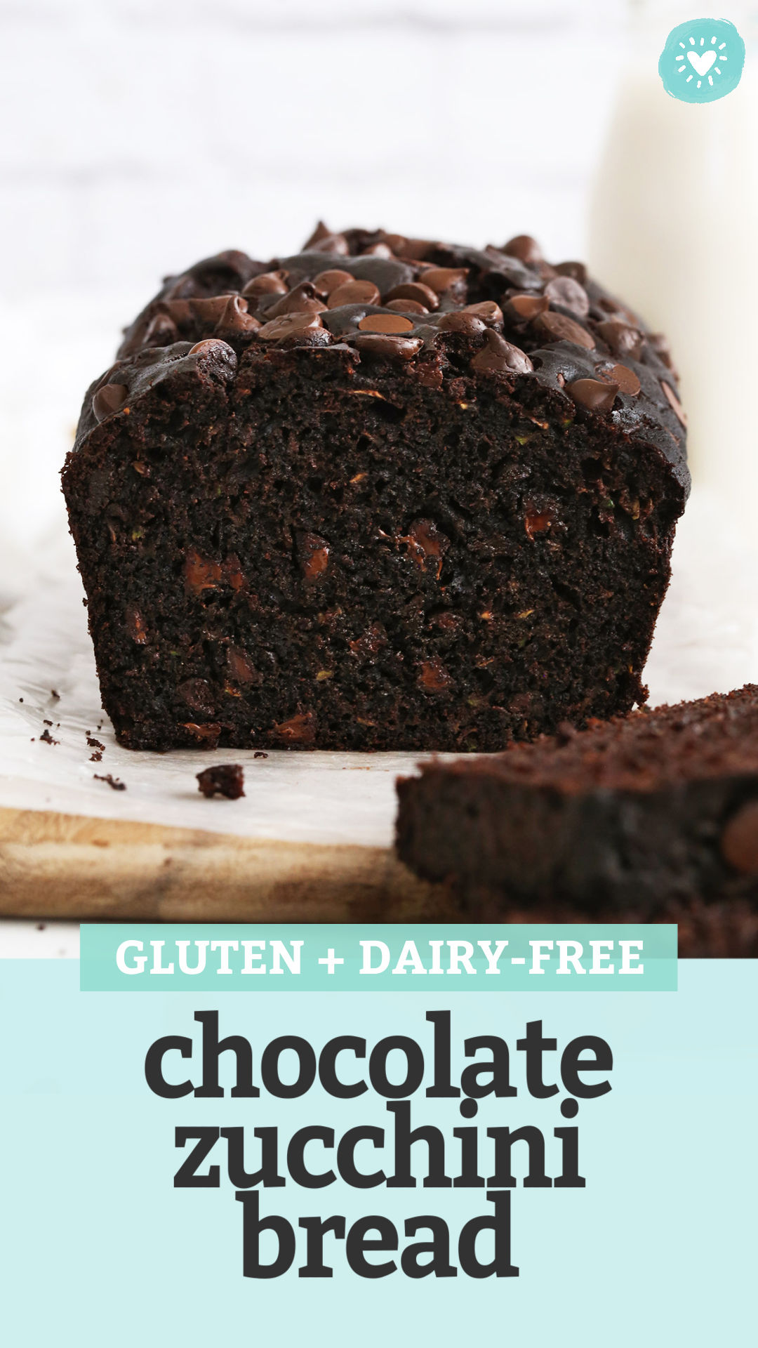 """A front view of a sliced loaf of gluten free chocolate zucchini bread with text overlay that reads """"Gluten + Dairy-Free Chocolate Zucchini Bread"""""""
