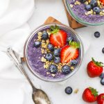 Blueberry chia pudding topped with fresh berries and granola.