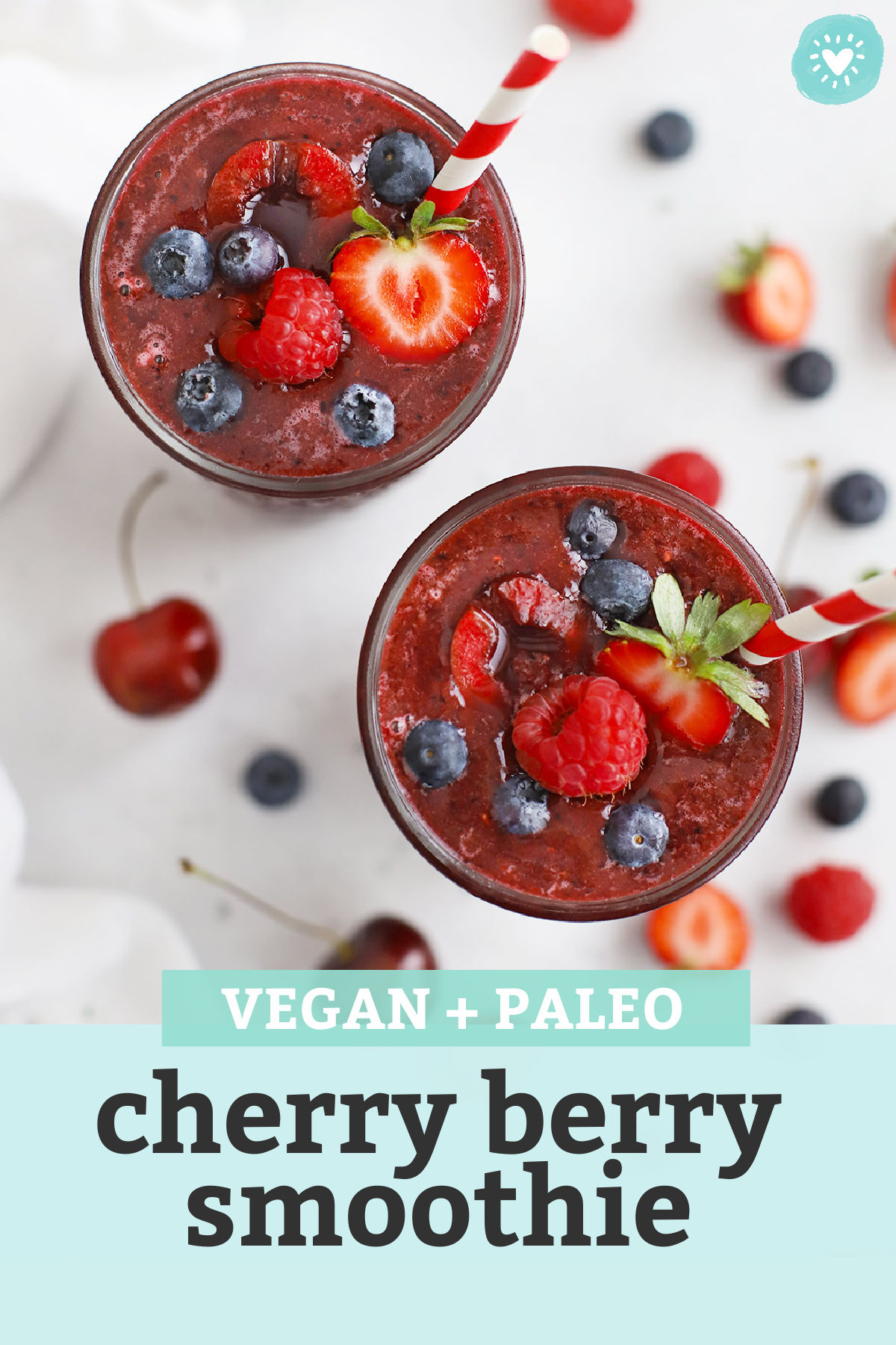 """Two glasses of Vegan Cherry Berry Smoothie with red and white straws with text overlay that reads """"Vegan + Paleo Cherry Berry Smoothie"""""""
