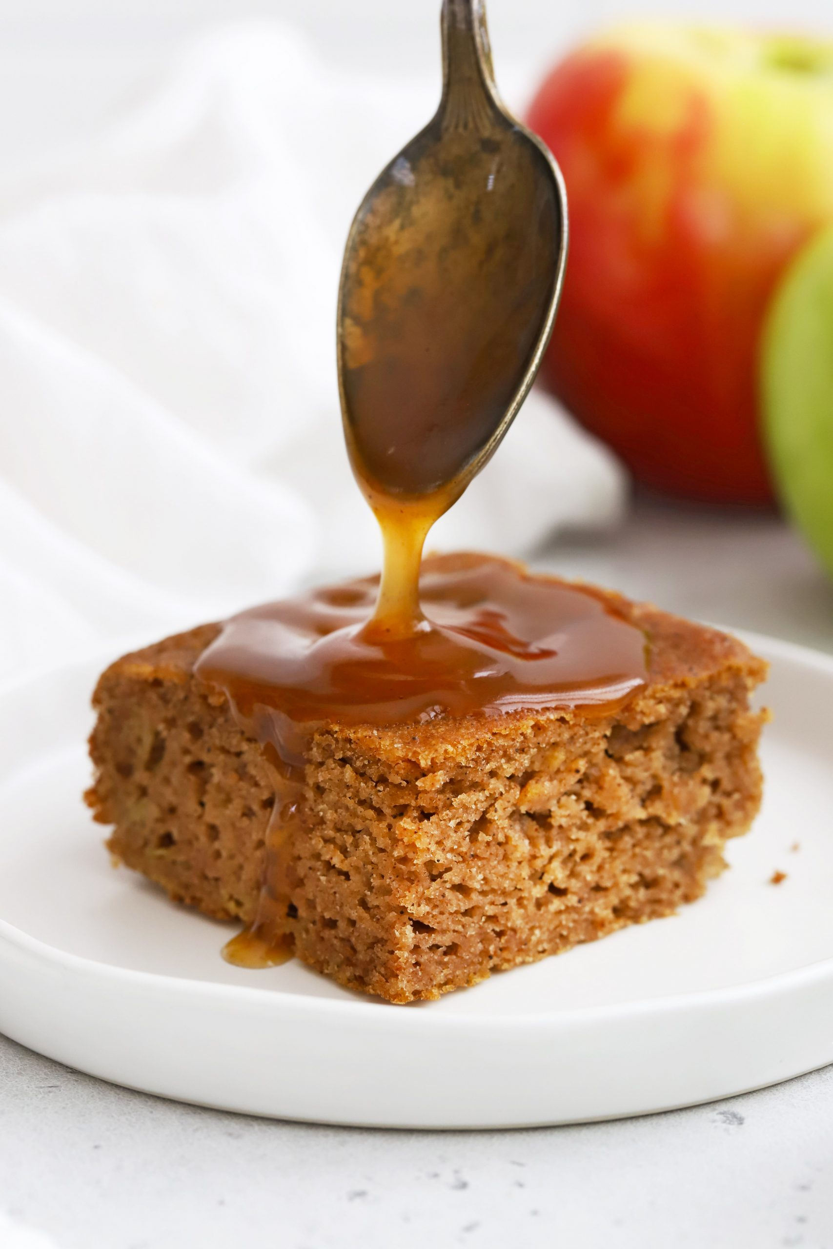 Cider Caramel Sauce being drizzled over apple spice cake