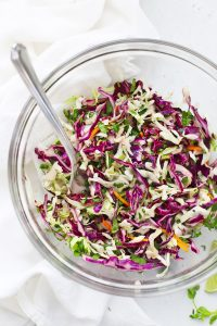Close-up view of Cilantro Lime Slaw in a glass bowl