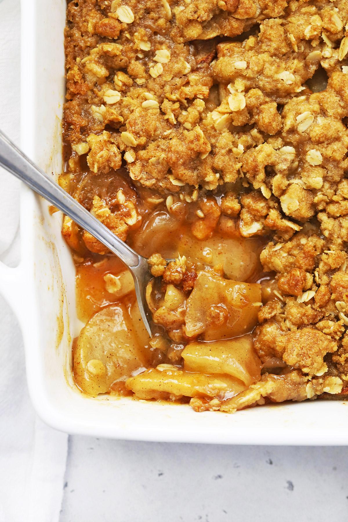 Scooping up gluten-free apple crisp.