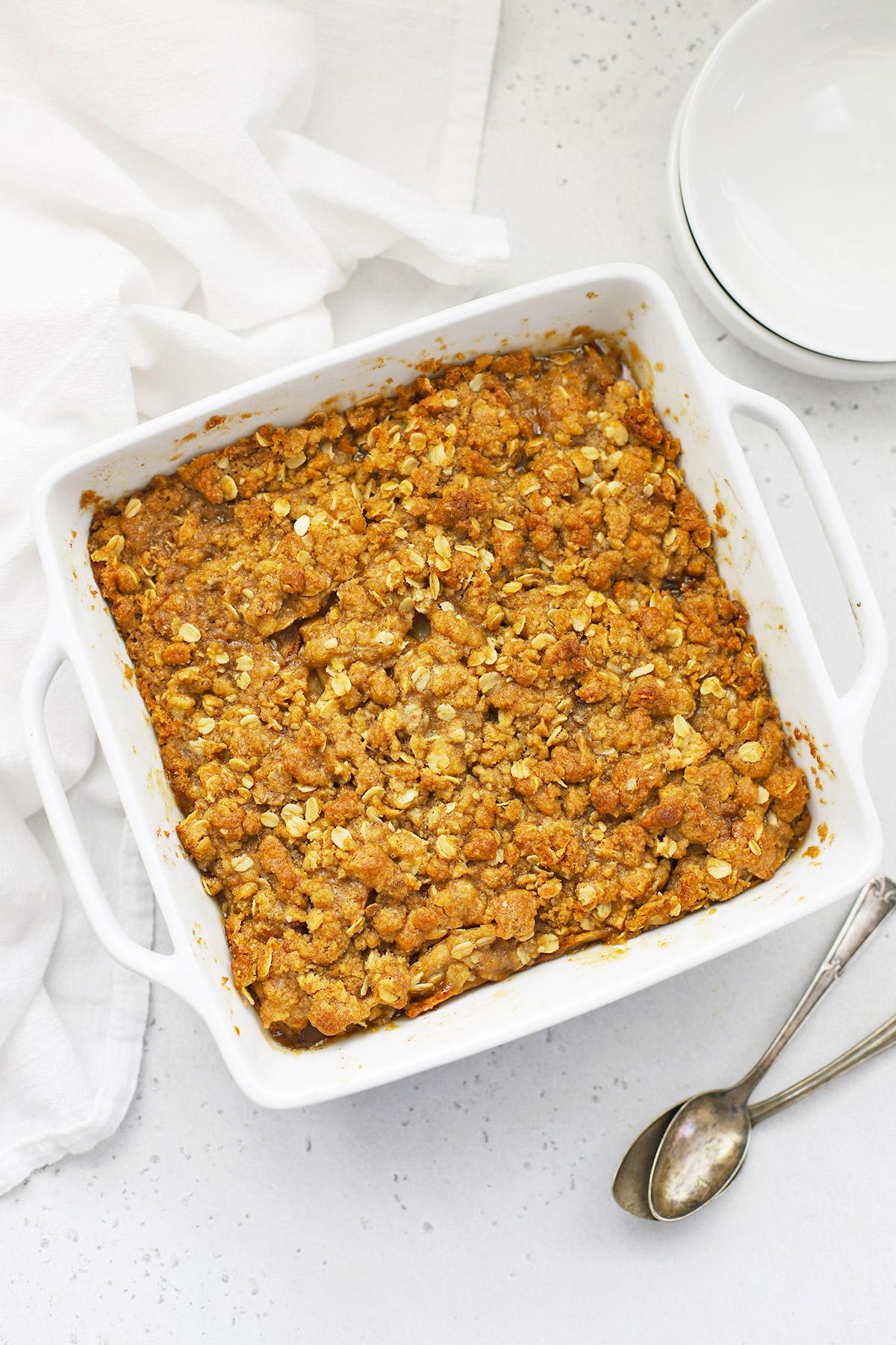 White baking dish of gluten-free apple crisp from One Lovely Life