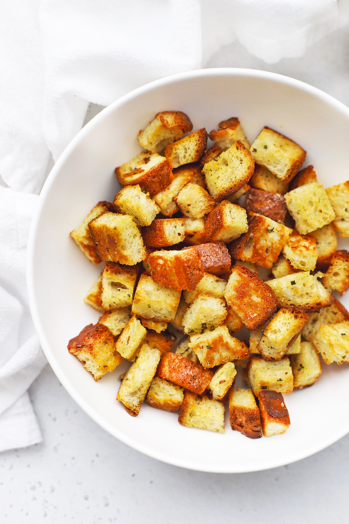 Close up view of gluten-free croutons in a white bowl
