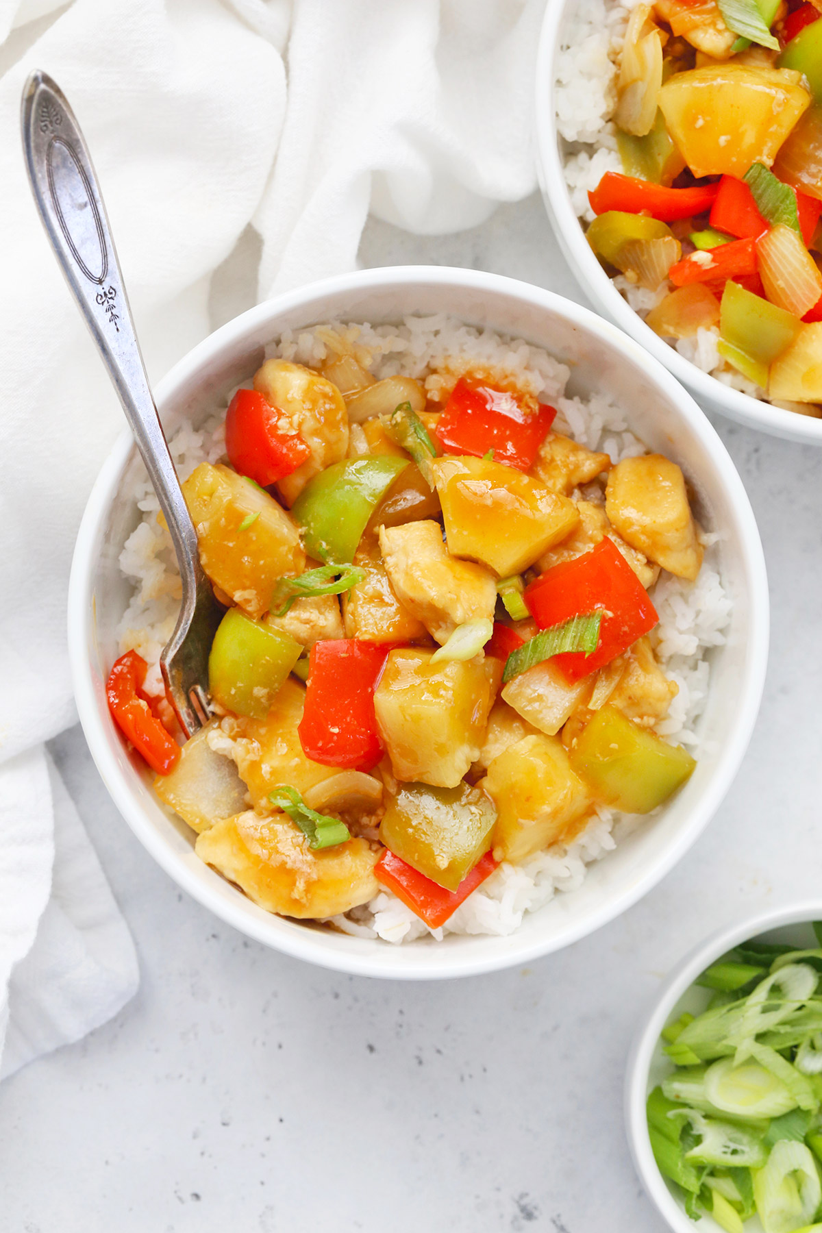 Close-up view of a bowl of Healthy Sweet and Sour Chicken