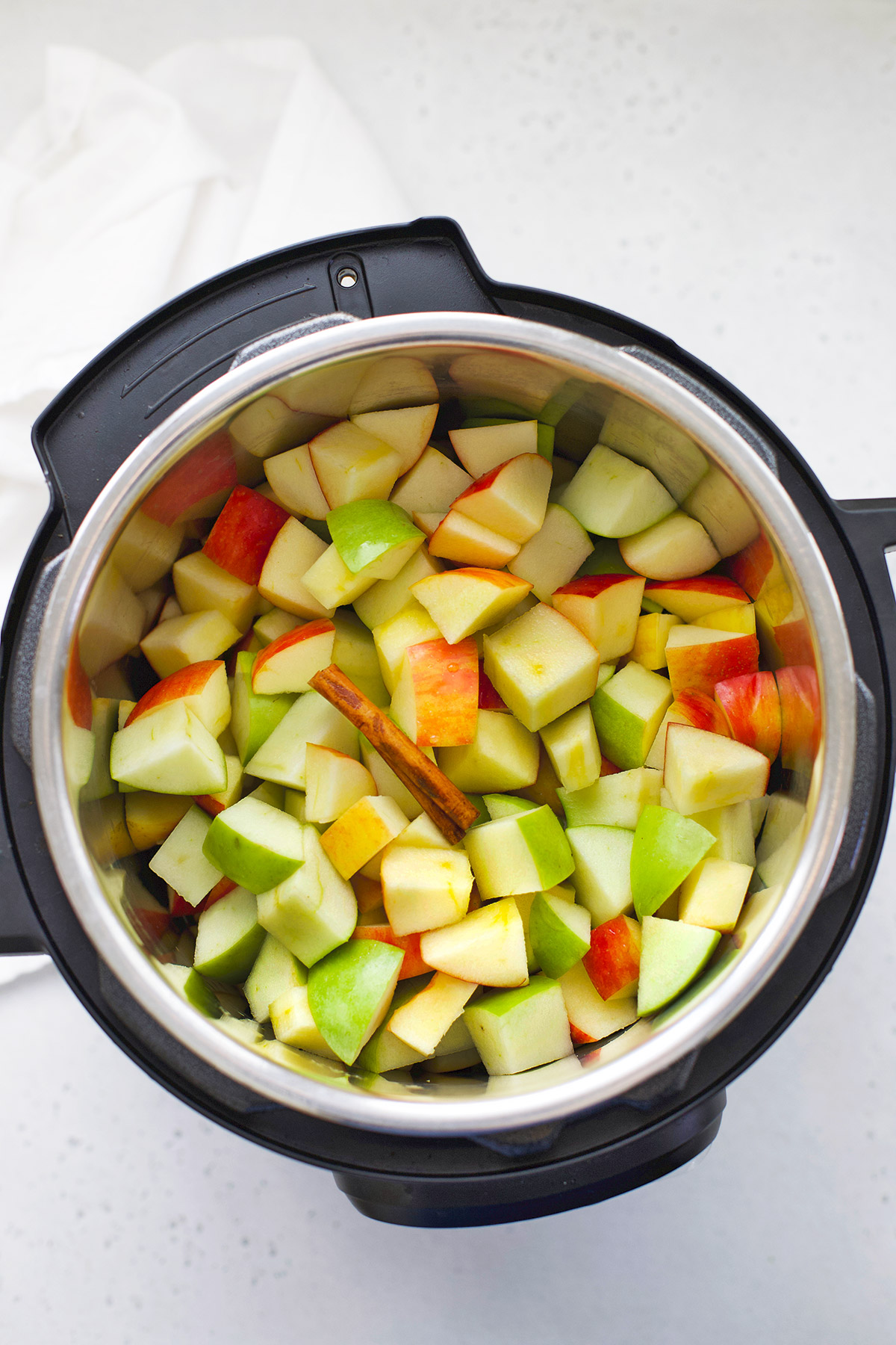Apples in an Instant Pot, ready to be turned into Instant Pot Applesauce