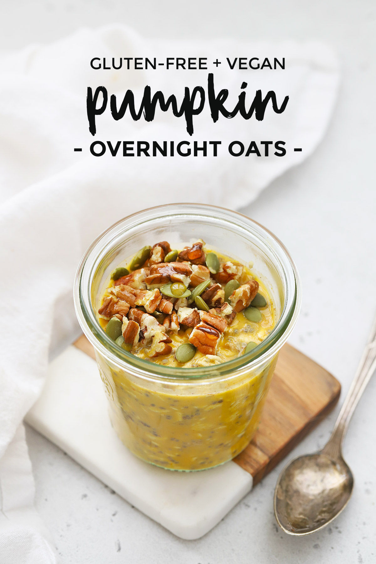 "Front view of a jar of pumpkin overnight oats with text overlay that reads ""gluten-free + vegan pumpkin overnight oats"""