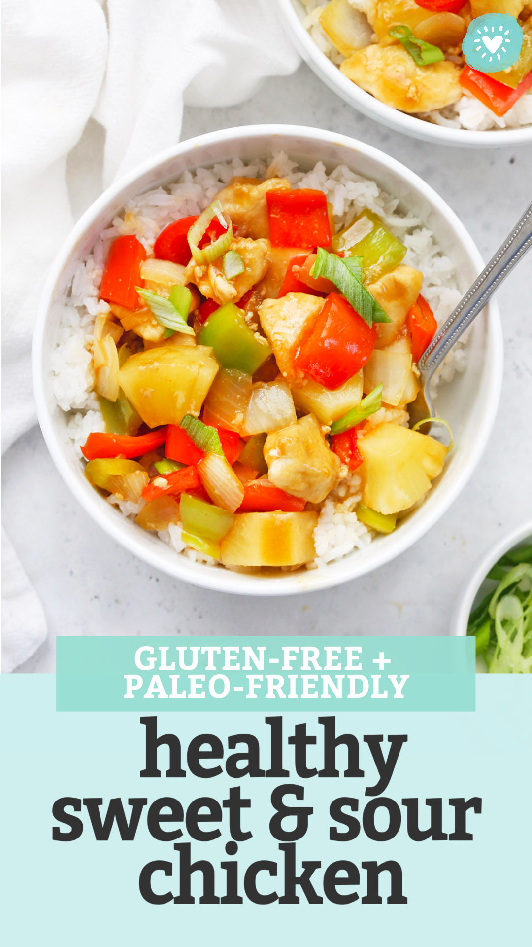 "Paleo-Friendly Healthy Sweet and Sour Chicken in a white bowl on a white background with text overlay that says ""Gluten-Free + Paleo-Friendly Healthy Sweet & Sour Chicken"""