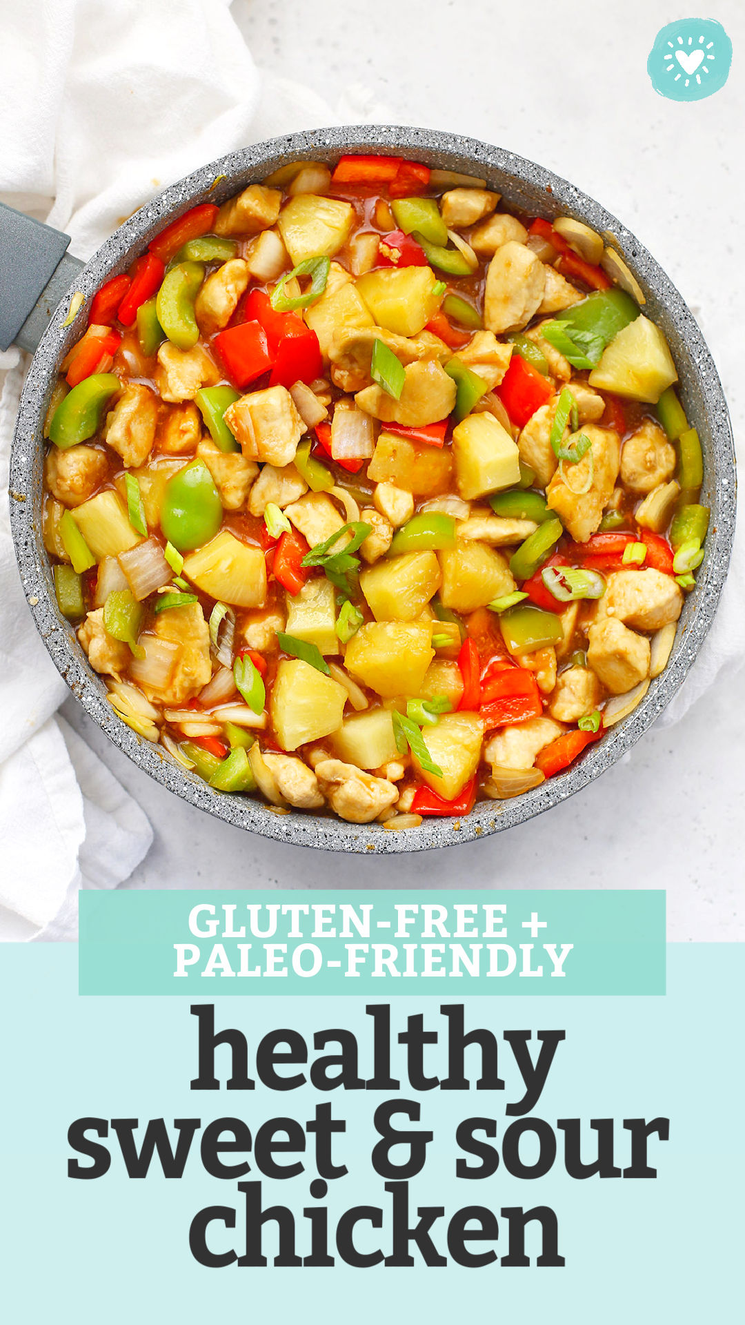 "A pan full of Healthy Sweet and Sour Chicken on a white background with text overlay that says ""Gluten-Free + Paleo-Friendly Healthy Sweet & Sour Chicken"""