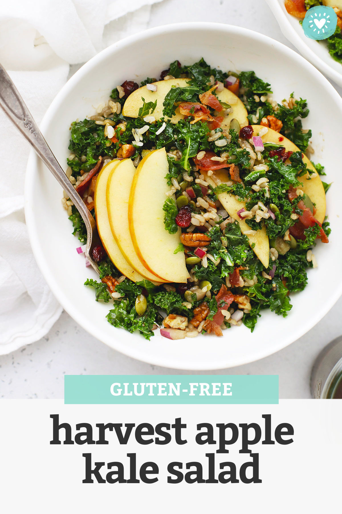 "White bowl of Harvest Apple Kale Salad with Balsamic Dressing with text overlay that reads ""Gluten-Free Harvest Apple Kale Salad"""