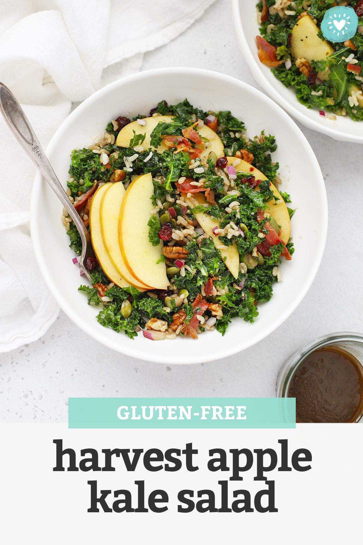 "Overhead view of bowls of Harvest Apple Kale Salad with Balsamic Dressing with text overlay that reads ""Gluten-Free Harvest Apple Kale Salad"""
