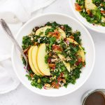 Overhead view of bowls of Harvest Apple Kale Salad with Balsamic Dressing